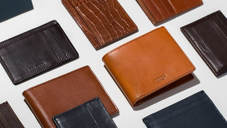 range of leather wallets arranged on a tabletop